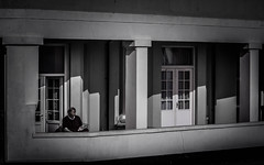 A framed read (pootlepod) Tags: street windows blackandwhite building monochrome photography reading framed pillars stphotographia