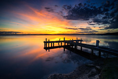 Squid's Ink (Leighton Wallis) Tags: blue sunset reflection yellow dusk belmont jetty sony australia nsw newsouthwales alpha oragne lakemacquarie f40 partlycloudy 1635mm mirrorless a7r squidsink emount ilce7r