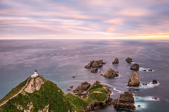 Nugget Point (Murphy Osborne Photo) Tags: ocean new travel pink blue light sunset sea lighthouse house seascape water beautiful point landscape island photography twilight rocks aqua pacific path south tide ngc adventure zealand current nugget headland trave