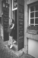 Gotcha! @ Maastricht (PaulHoo) Tags: maastricht bw blackandwhite monochrome 2016 limburg holland netherlands city urban lumix girl woman vignette vignetting street streetcandid streetphotography restaurant candid trapped bar horeca beauty lady