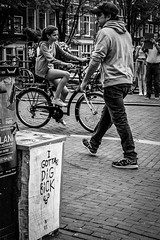 I gotta big dick @ Amsterdam (PaulHoo) Tags: amsterdam city holland urban netherlands street streetphotography streetcandid candid 2016 citylife cycling bicycle bike text walking passenger monochrome bw blackandwhite vignette vignetting lumix nik silverefex lightroom