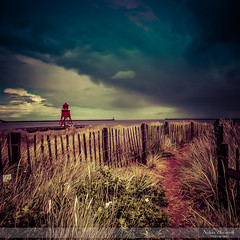 The Groyne (Nathan Dodsworth Photography) Tags: southshields littlehaven beach northeast england sky colour weather moodatmospheric light groyne lighthouse pier fence sands grasses clouds movement dramatic