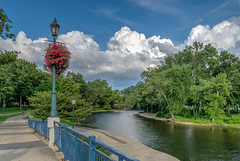 A Walk in the Park (tquist24) Tags: elkhart hdr hff indiana islandpark nikon nikond5300 outdoor stjosephriver bridge clouds fence flowers geotagged park river sky tree trees unitedstates