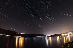 SpringStarTrails (Tomislav C.) Tags: light sea panorama night stars landscape lights star landscapes timelapse spring rocks waves time croatia rotation lapse adriatic hrvatska nightlapse