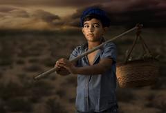 Child farms (ali darwish233) Tags: lighting boy people work canon photography photo bahrain farmer علي تصوير البحرين photogarpher درويش مزارع مصور فلاح alidarwish