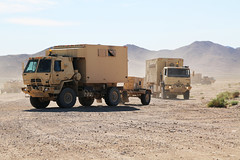 FORT IRWIN, Calif.  U. S. Army Soldiers assigned to 864th Engineering Battalion, 1st Infantry Division, move supplies and equipment during Decisive Action Rotation 15-06 at the National Training Center here, March 25, 2015. Decisive action rotations at t (Operations Group, National Training Center) Tags: california usa calif soldiers troops mohave fortirwin combatcamera nationaltrainingcenter opsgroup combatphotographers