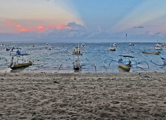 Bali - Sanur Sunset (zorro1945) Tags: bali indonesia asia sanur sanurbeach beach sand sea clouds sunlitclouds eveningsky eveninglight sunset sundown gloaming nightfall boats outriggers flickrtravelaward