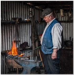 The forge (Hugh Stanton) Tags: fire wwii tools blacksmith forge anvil