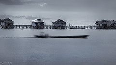 Bajau - Life on the Water (Collin Key) Tags: path houses serene pier togianislands seanomads indonesia sea ocean monochrome movementblur sulawesi malenge child boat huts mother bajau seagypsies idn