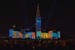 Sound and light show on the Canadian Parliament (beyondhue) Tags: canadian parliament sound light northern lights projection peace tower people crowd beyondhue canada ontario ottawa night lawn spectator