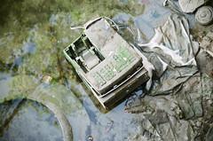 (pop archaeologist) Tags: cashregister washedup shore gowanuscanal shirts water mud wet garbage brooklyn newyork city nyc film fuji reala100 soligor80200 canon eoselan7