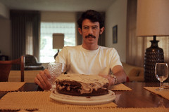 Steve at dining table, with cake (SteveOwen52) Tags: 1973 longbeach