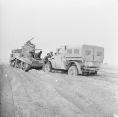 A Stuart tank comes to the rescue of a truck which has become stuck in soft sand near Nufilia, 26 December 1942