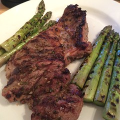 Butterflied leg of lamb with grilled asparagus.