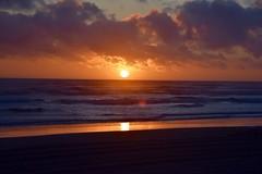 Sunset on the Oregon coast in Warrenton. (calex14_photog) Tags: ocean sunset sea orange cloud beach nature water clouds oregon agua nikon waves nubes oregoncoast olas puestadelsol nikonphotography nikond750