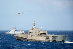 USS Coronado (LCS 4) and the People's Liberation Army (Navy) guided-missile destroyer Xian transit in formation.