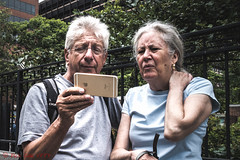 No Smile Selfie (ViewFromTheStreet) Tags: allrightsreserved blick blickcalle blickcallevfts calle candid chestnutstreet copyright2016 pennsylvania philadelphia photography stphotographia streetphotography viewfromthestreet amazing classic couple elderlycouple female iphone male man nosmileselfie selfie street vftsviewfromthestreet woman blickcallevfts copyright2016blickcalle