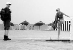 beach activity III (toni jara) Tags: girl upskirt beach bw monocromtico blancoynegro airelibre candid robado malvarrosa sanpatricio