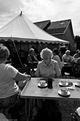 Village fete (14) (Neil. Moralee) Tags: july2016nikond7100 neilmoralee hemyock village fete neil moralee nikon d7100 man matute old laughing funny bald balding shirt moustache happy smile smiling back white mono monochrome bw candid face portrait outdoor people natural light blackdown hills rural event local hat fun summer comunity support devon uk
