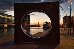 Framing (ULundquist) Tags: momument stone circle hole framing malm outdoor frame sweden sunset lighthouse boat art evening buildings clouds rock