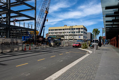 One Way Taffic for Now (Jocey K) Tags: christchurch newzealand southisland architecture buildings rebuild construction deconstruction cranes demolition roadcones street road crossingcarparkingbuilding rebuilds sign clouds sky lichfieldstreet businterchange cars trees