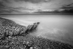 Porlock Harbour Groynes 02 (Photograferry) Tags: exmoor nationalpark uk southwest england outside nopeople landscape nature 2016 porlockwier porlock ocean longexposure groynes pebbles shore sea coast wooden old weathered