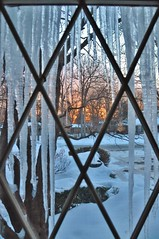 View through the window and the icicles (stevelamb007) Tags: winter usa snow ice window sunrise dawn us illinois nikon lincolnshire telephoto nikkor icicles 18200mm d90 stevelamb