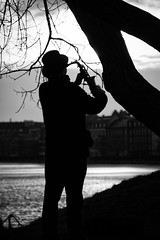 The Sunset Saxophonist (virtualwayfarer) Tags: street travel sunset blackandwhite bw music lake canon copenhagen denmark europe european euro lakes streetphotography lifestyle busker dailylife cph scandinavia sax danmark saxophone bnw musicman thelakes magicmoment blackandwhitephotography kobenhavn dronninglouisesbro travelblogging happiestcountry