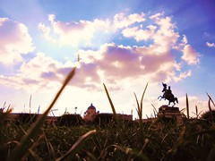 Clouds through the Grass (valenzacalogero) Tags: vienna wien blue light sky horse sun white travelling green monument nature grass silhouette clouds contrast austria cool europe day tour shadows awesome sightseeing lawn super journey dome oh position hallo wunderbar danke