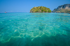 Clear water and blue sky. Beach in Krabi province, Thailand. (print.tani) Tags: trip travel blue sea summer vacation sky cliff seascape beach nature water beautiful coral rock strand relax landscape thailand island bay coast seaside scenery asia paradise waterfront view turquoise horizon sunny lagoon clear journey shore thai destination recreation seashore tranquil krabi andaman poda