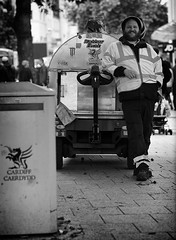 The Happy Cleaning Operative (Just Ard) Tags: man cleaner rubbish waste bin refuse operative people person face street photography candid unposed black white mono monochrome bw blackandwhite noiretblanc biancoenero schwarzundweis zwartwit blancoynegro  justard nikon d750 85mm