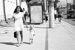 (nVa17) Tags: street light summer blackandwhite bw woman white walking blackwhite child walk strangers streetphotography streetphoto perm bnw motherandchild blackandwhitephotography      ladyinwhite 53mm