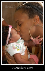 A Mother's Love (daddydell28) Tags: nikond40 mother child bra bradleyimages kiss blackwoman woman brownskinwoman baby earrings