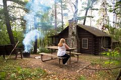 Carole outside our cabin, Itasca State Park (vambo25) Tags: minnesota itasca lakeitasca itascastatepark