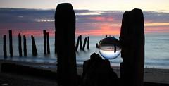 EDGE OF THE WORLD SUNRISE (car 67) Tags: mirrorball glassball groynes yorkshire sunrise coast sand deposit