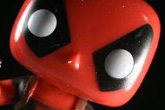 Unbalanced (FilmandFocusPhoto) Tags: red white black macro canon toy 50mm sigma wilson bobblehead wade figurine marvel todayspic dutchangle macrophotography noprocessing deadpool photoshopfree wadewilson macrounlimited macrodreams