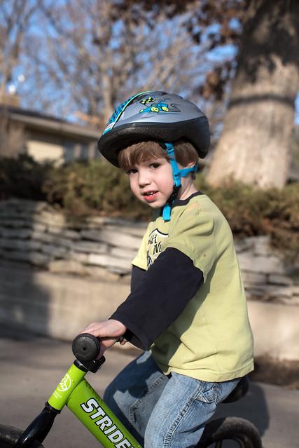 Working on his balance bike riding
