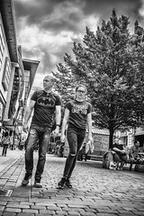 Looking good (tootdood) Tags: canon70d blackandwhite streetcandid candid fromthehip trees leaves cobbles couple looking good iwokeuplikethis batman stormy sky