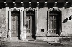 Three Doors (albireo 2006) Tags: valletta malta blackwhitephotos blackandwhite blackandwhitephotos blackwhite bw bn nb pb doors