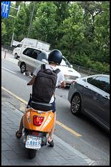 8857 - funky scooter (hej_pk / Philip) Tags: fuji fujifilm x100s fujix100s fujinon fujinon23mmf2 23mmf20 23mm35mm gwangju kwangju sydkorea gator streets frgrik skoter scooter orange bright road