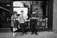 The Family (nigelhunter) Tags: family kendal cap trio street candid bio oil shop bag pavement urban woman man youth lad