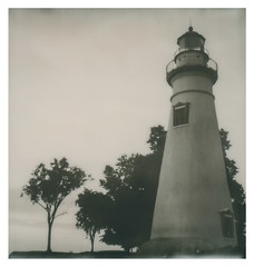 Marble Head Lighthouse (The Stugots) Tags: polaroid impossible project film black white bnw bw sx70 instant camera sunrise lake erie ohio clouds nature morning lighthouse marble head marblehead