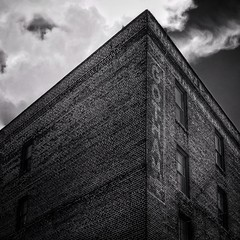 """moonstruck monochrome (listening to """"the bane rendition"""", the raconteurs) (jeneksmith) Tags: minimal clouds sky angles lettering letters paint brick building bigeasy crescentcity nola urban city neworleans monochrome gray grey blackandwhite bw canon"""