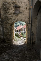 IMG_1346 (jsgcowley) Tags: europe italy bogli village street arch cobblestone texture house architecture