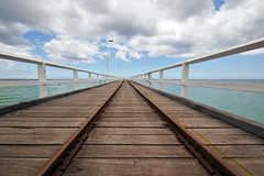 Busselton Jetty Railway | Busselton, Western Australia (Ping Timeout) Tags: street wood old blue sea summer vacation sky cloud holiday green heritage texture beach water look weather st metal train out bay coast wooden sand rust scenery afternoon underwater view oz jetty centre under tram rail railway australia down visit scene icon front symmetry line queen southern observatory western wa sight railing longest 18 beachfront km attraction busselton hemisphere interpretive geographe