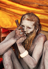 Naga Sadhu smoking his chillum (kissoflif3) Tags: india naked indian pipe streetphotography streetportrait monk oldman smoking rings ash chillum sadhu ascetic allahabad kumbhmela nagasadhu junaakhada ashsmearedsadhu