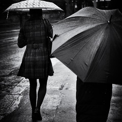 Raining Out There (Fuji and I) Tags: street rain weather blackandwhite umbrellas monochrome alexarnaoudov
