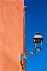 bosa (heavenuphere) Tags: bosa oristano sardegna sardinia sardinie italia italy europe island colourful houses architecture orange wall blue sky lantern 24105mm
