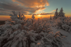 Surrounded by Subtle White Fire II... (Bonnie And Clyde Creative Images) Tags: landscapes canon canon5d winter snow mountains sunrise sun popular