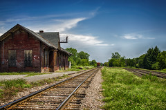 All Steam and Whistles Heading West (flashfix) Tags: july272016 2016 2016inphotos nikond7000 nikon massonangers quebec landscape canada 40mm trainstation traintracks bluesky textures architecture building abandoned lines clouds